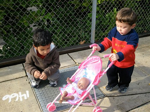 Even boys love to push dolls around in strollers