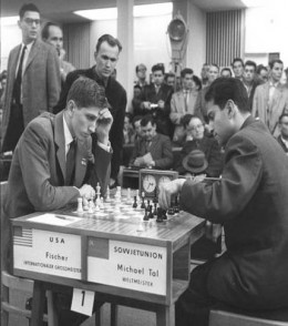 Fischer at the age of 17 playing world champion Mikhail Tal in Leipzig.