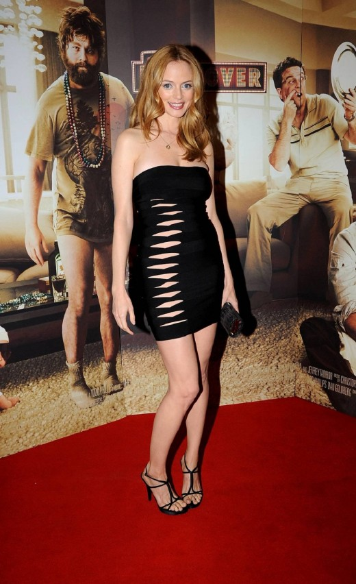 Heather Graham in a strapless black dress with sexy cutouts and wearing high heels