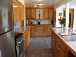 This photo of a kitchen that was a complete DIY project shows a more affordable option for granite countertops. This DIYer simply adhered 12x12 granite tile to the countertop and then grouted it. A solid granite countertop will cost upwards of $75 pe