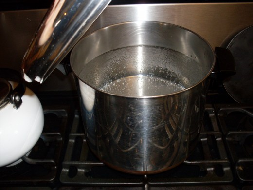 Heat drinking water to boiling - enough to cover sliced cucumbers.