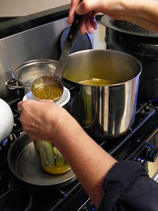 Ladle hot solution over cucmbers, leaving 1/2-inch headspace. Wipe rim of jar with clean, damp cloth.