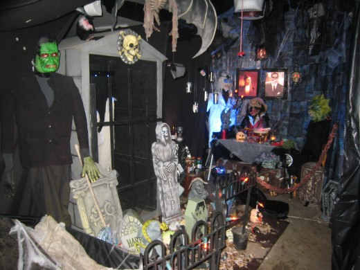 Halloween 2008 I transformed the garage into a walk thru cemetery and castle dining room.