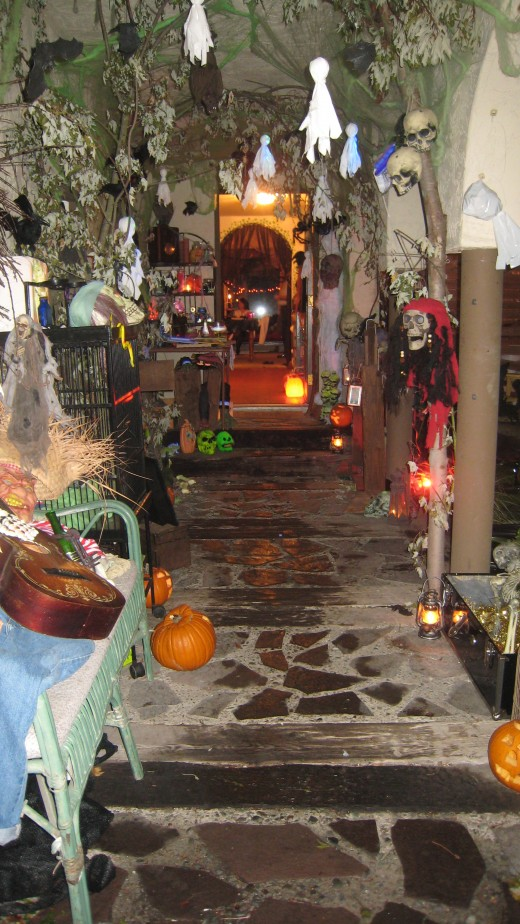 Our entryway is lined with trees, skeletons, skulls, plenty of bats and many jack-o-lanterns.