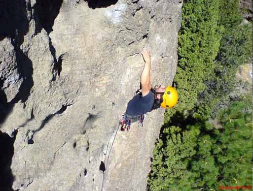 The Author climbing in Valle Encantado - Neuquen - Argentina. Helmet in the Photo: Half Dome, one of the most popular helmets on the market. At 90ºF a little more ventilation could have been handy.