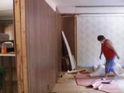 Flooring coverings have been removed. This wall is now gone!
