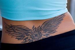 woman's lower back tattoo