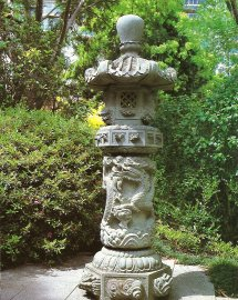 A magnificently carved stone lantern adorns an intimate corner.