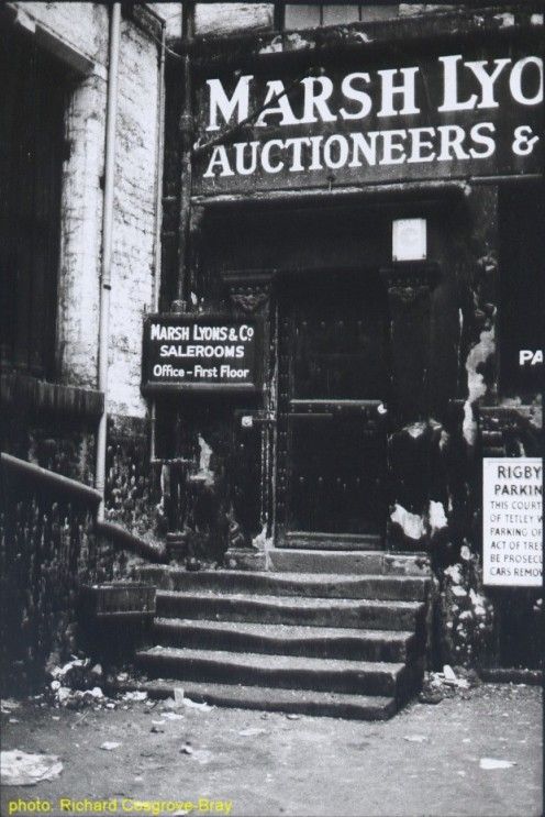 Just off Dale Street, in the city's business quarter, stood these old auction rooms.  Notice the wear of ages on the stone steps.