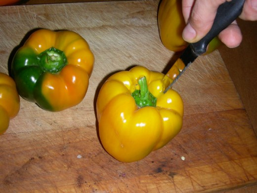 Cut the cap of each pepper and clean inside
