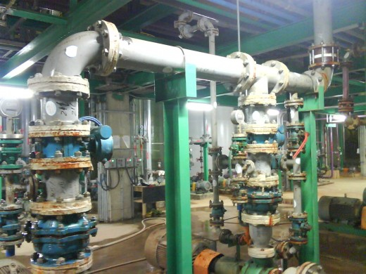 Pump discharge piping is supported by two I-section supports (green).