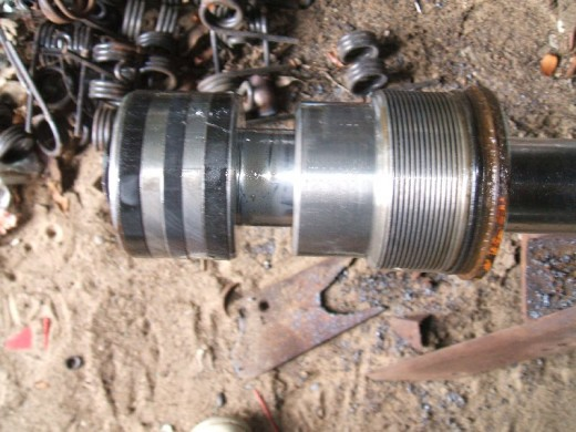 Piston and gland after removal from piston rod