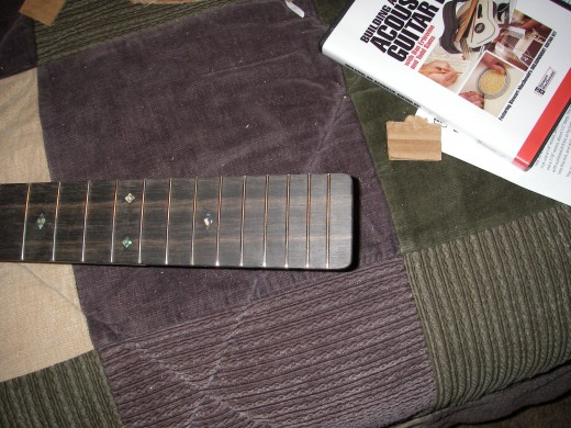 Rounded fret board