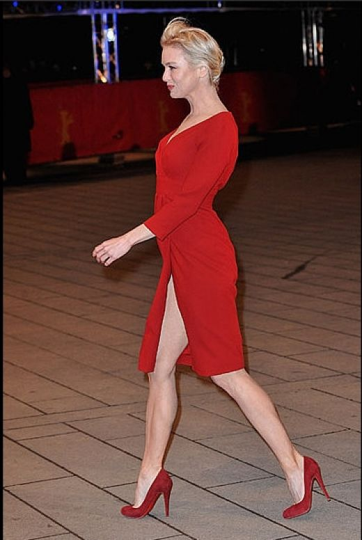 Renee Zellweger wearing red suede Christian Louboutin pumps