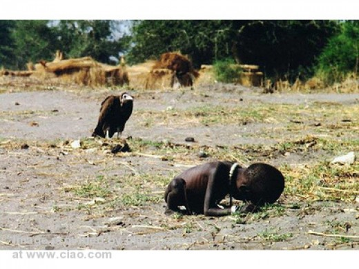 A child dying of starvation as a buzzard looks on awaiting a meal.Maybe if he breaths deeper he can survive.