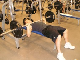 The Down position of the flat bench exercise.