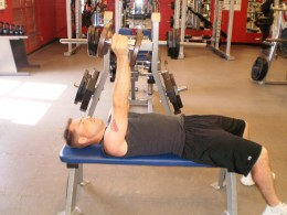 Flat Bench Dumbbell press up position