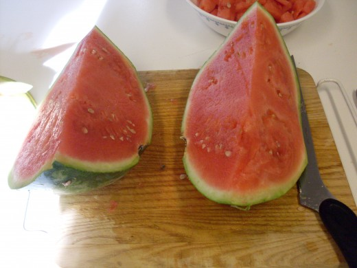 Make sure outside of melon is clean. Begin by slicing melon into manageable chunks.