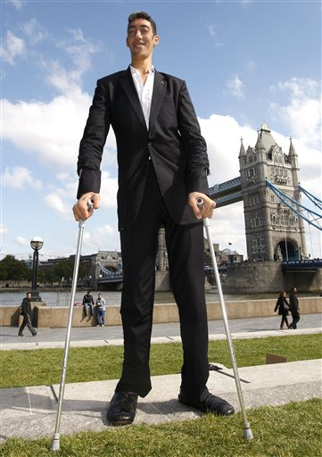 In this Wed- Sept. 16, 2009 photo, Sultan Kosen, 26, standing in front of Tower Bridge, London was officially crowned by Guinness Book of Record as the latest world's tallest man.