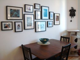 Using photographs for wall decor can create a homely atmosphere.