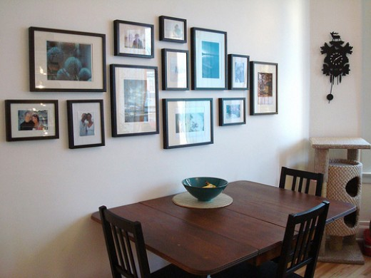 Using photographs for wall décor can create a homely atmosphere.
