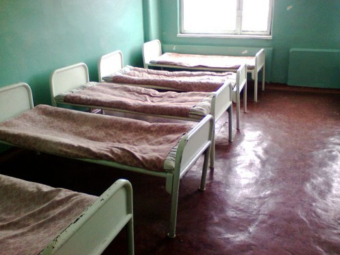 A ward of hopsital beds in a poor region (public domain).