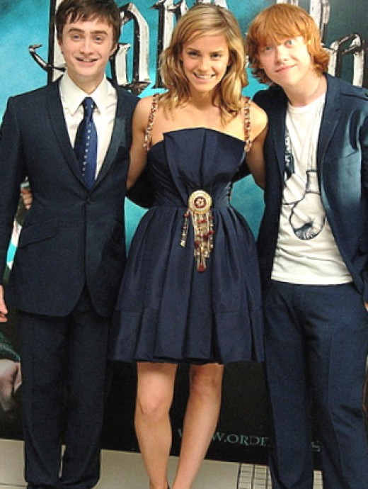 Daniel Radcliffe with fellow young actors, Emma Watson and Rupert Grint.