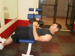 The Roman Chair Weighted Sit-up start position