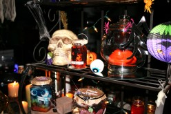 "Many interesting details in the witches kitchen display, glass jars with ""gummie eyeballs"", a meat wrapper like in the grocery store but instead of hamburger or steak it has a label that reads Fresh Vampires' Brains, and has  gooey brains packaged!"