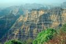 Deccan Traps.  Shows layers of basalt magma placed over thousands of years.    arstechnica.com photo