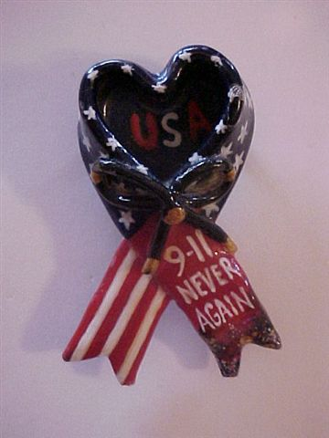This pin created by me was given out at Ground Zero by the clergy division assigned to comfort rescuers coming out of the pit.