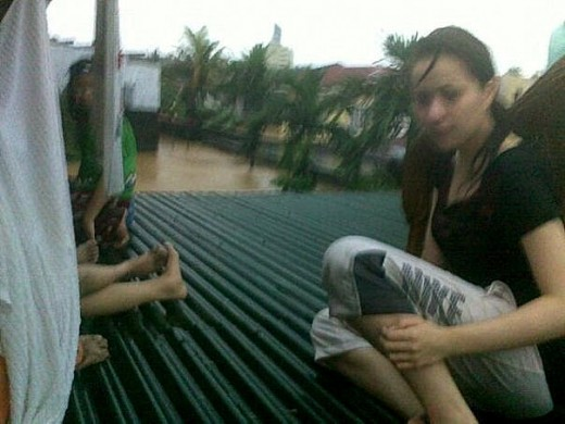 Local movie star Kristine Reyes atop her roof waiting for rescue
