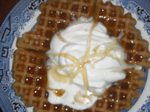 waffle with freshly whipped cream and maple syrup