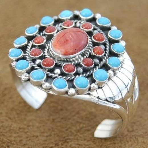 Turquoise and coral on sterling silver cuff.