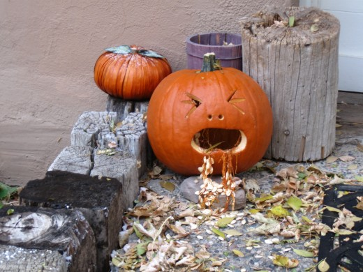 A little sick but quite creative.  This particular Jack-O-Lantern graced the porch of a small office inTaos, New Mexico