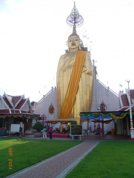 The golden Buddha in Bangkok. THere 250,000 Chinese, 100,000 Indians, 45 000 Europeans and 30,000 Japanese and most of them are very respectful of main Buddhist Religion.