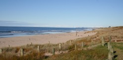 Long, wide Papamoa Beach- on a low surf day!