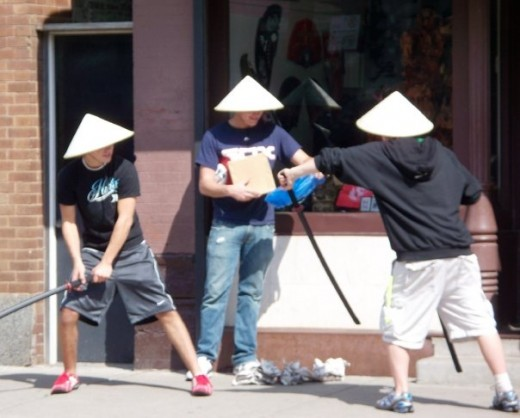 three China men sweeping the street-courtesy of my friend, Mary Wilson