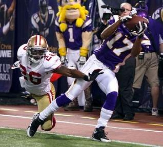 Viking WR Greg Lewis' spectacular game winning catch vs. the Niners.