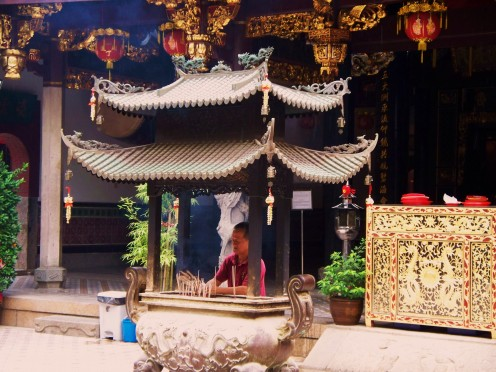 Incense burning in a Buddhist temple. Singapore