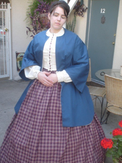 This costume of a simple skirt and blouse was dressed up with a light weight jacket