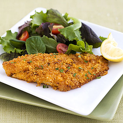 Delicious Big Easy Cajun Tilapia. Serve with a simple salad made of salad greens and sliced cherry tomatoes and serve with lemon wedges. This fish is so delicious.