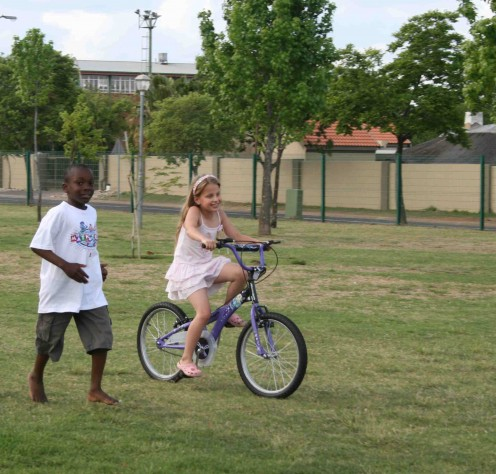 Caitlin riding well now - this was taken a few days ago. She is with a school friend