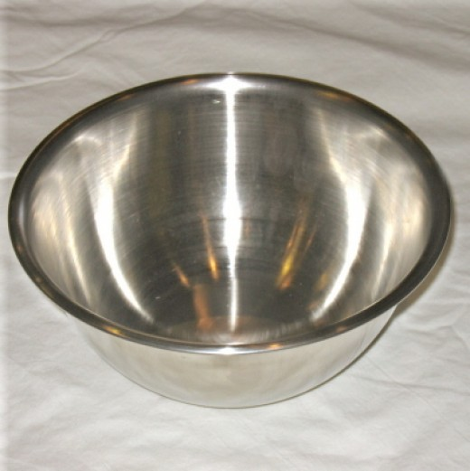 You want a large metal mixing bowl and you want to freeze it at least 4 hours in the freezer before you use it.