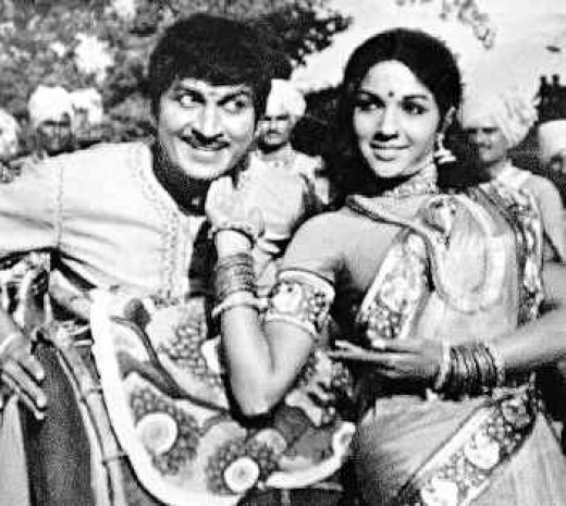 Dr.Raj, with actress Arathi,in  a black and white film