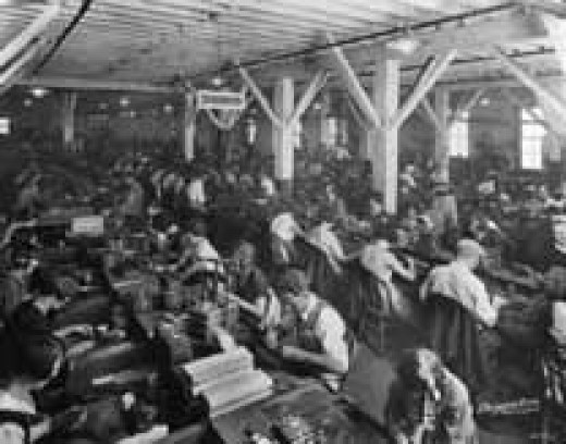 Historical image of factory workers. Looks like a fun place to work.