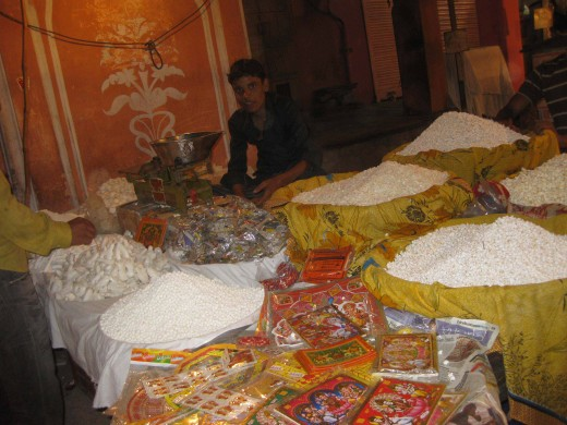 Shopkeeper selling Pujan Samagri on Dhan Teras