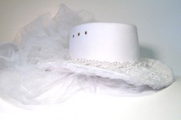 White Western style wedding hat goes well with the Victorian lace dress and Victorian leather and lace boots