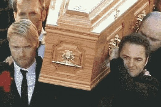 Ronan Keating on the left and Boyzone members helped carry Stephen's coffin