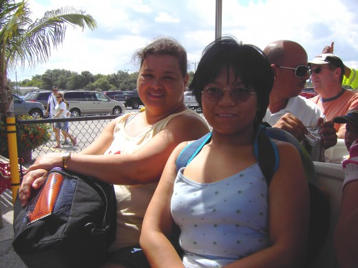 Me and my aunt, with an Argentinean youth herd behind and beside us, on the tram to Busch Gardens (July 18, 2009)